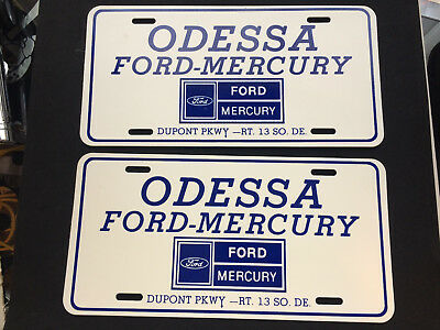 (2) Vintage Plastic Odessa Delaware Ford Mercury Car Dealer Sales License Plates