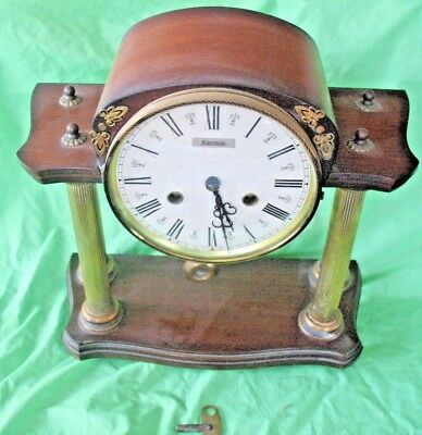 Old vintage FRANZE HERMLE chiming mantle clock mounted on 4 brass pillars