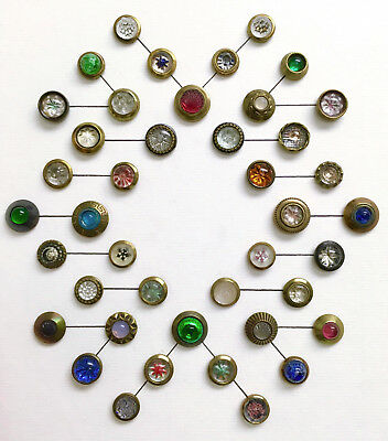 Beautiful card of 42 Westkits buttons with glass centers. All different. Mint!