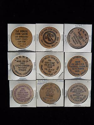 Nine Wooden Nickels From Coin Shows 1965-1997