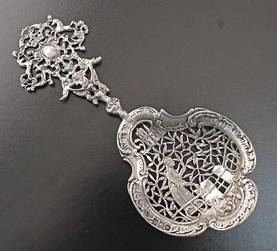 English 1898 Sterling Figural Strainer Ladle