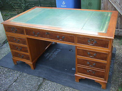 A large antique reproduction yew wood pedestal desk green leather 60ins wide