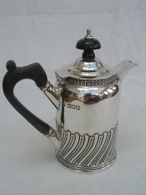 A Fine Solid Sterling Silver Small Size Coffee Pot By Thomas Bradbury & Sons.