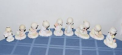 Lot 9 Precious Moments Growing In Grace Figurines: It's a girl, 1,2,3,4,5,6,7,8