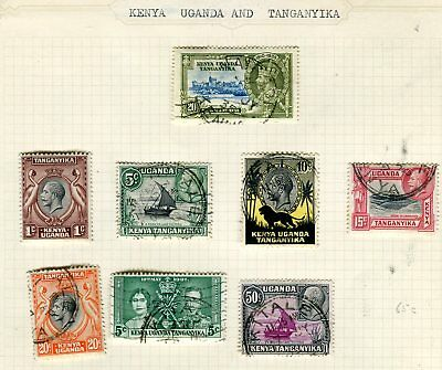Stamps of Kenya, Uganda and Tanganyika on part album pages.