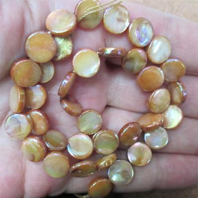 """15.25"""" strand of Mother-of-Pearl, gold/peach, Disk Beads, 10mm"""