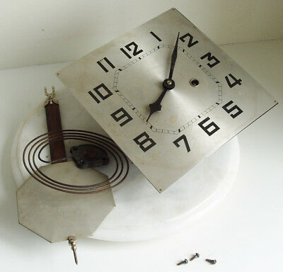 Vintage wall clock movement with pendulum and gong
