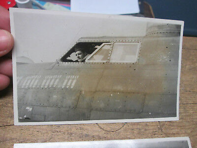 LOT of 2 vintage original WWII photographs BOMBER PILOT in COCKPIT of AIRPLANE
