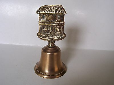 VINTAGE  BRASS   HAND    BELL  with old thatched cottage handle .VERY NICE