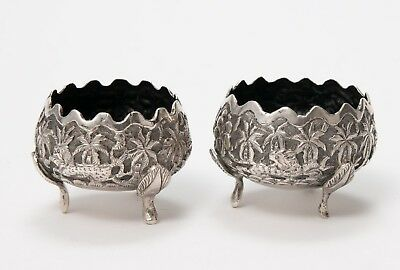 Pair of Antique Indian White Metal Repousse Table Salts with Animals & Tri Feet