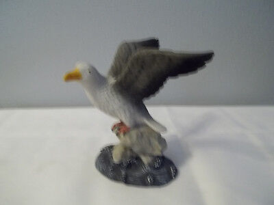 """Small Hard Resin Seagull On Rock Surrounded By Water 4 1/4"""" Tall"""