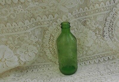 Mountain Dew Hillbilly Tickle Your Inard Embossed 10 Fl. oz.  Green Bottle