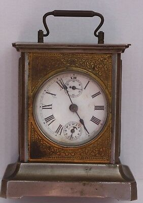 Old, heavy, wind-up, musical,  carriage clock.