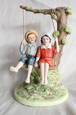 """Summer Fun"" Norman Rockwell figurine depicting sweethearts on a tree swing."