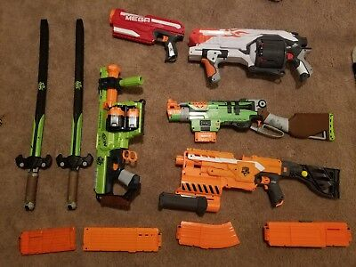 LARGE NERF GUN LOT W/AMMO AND 2 SWORDS (bin not included)