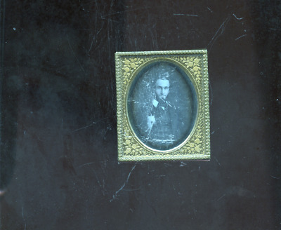 nice hand colored unidentified sixth plate daguerreotype photo of a man