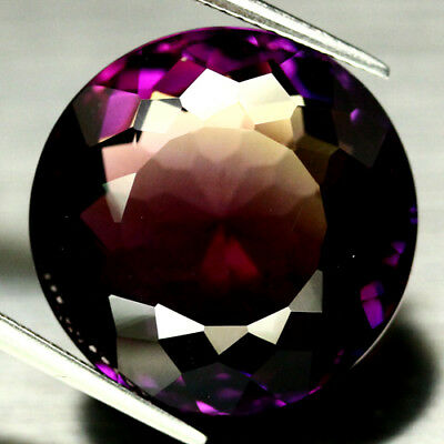 21.14 CT AAA! PURPLE & GOLDEN BOLIVIA AMETRINE ROUND 18 mm.