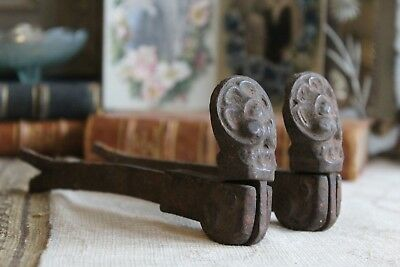 An Ornate Pair of Antique French Cast Iron Window Shutter Dogs Holders