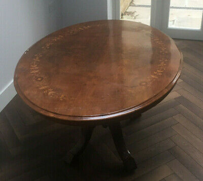 Antique Oval Walnut Table - Features  Carved Central Foot and Inlaid Wood Work