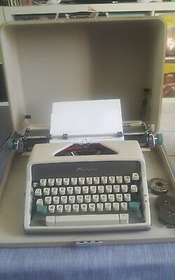 "machine a ecrire Olympia SM7 deluxe Vintage typewriter  13"" in case"