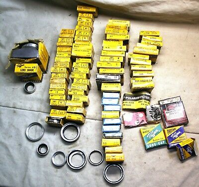 Lot of 82 mostly new in old boxes Tiffen filters,adapter rings,lenscaps+ChartEtc