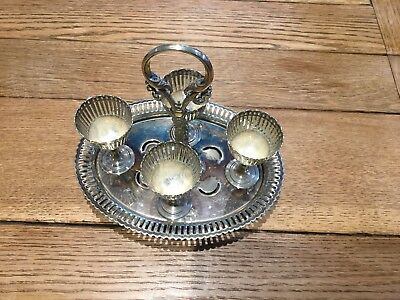 Vintage silver plated 4 egg cup holder. Age unknown.