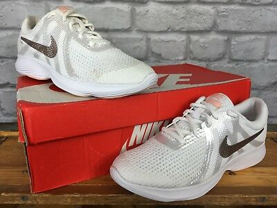 9cd2fa1446d284 Nike Revolution 4 White gold Trainers Various Size Children