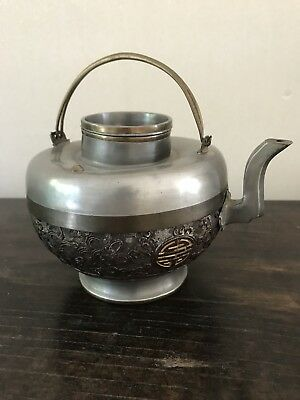 Old Chinese metal and wooden teapot