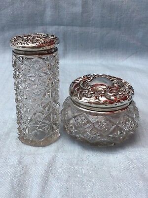 A pair of Edwardian cut glass sterling silver topped ladies dressing Table Jars