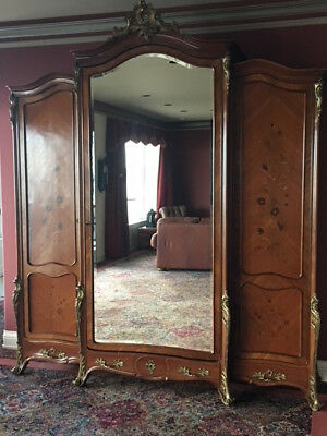 Beautiful antique french armorer with beveled mirror.