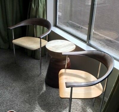 Pair of Vintage Mid Century Modern contemporary chairs genuine leather .