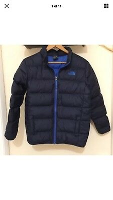 The North face boys size 14-16 blue 550 fill pre owned