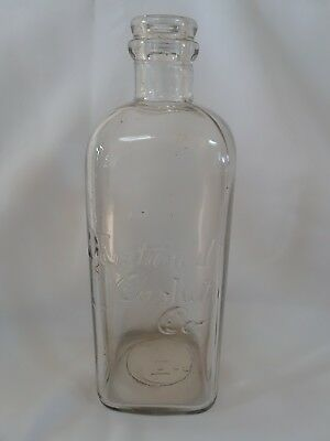 NATIONAL CASKET CO. embossed embalming fluid bottle- undamaged