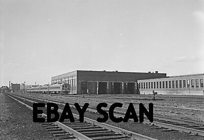 ORIG NEG Boston & Maine diesel shop in the 1950s with RDCs in Minuteman paint