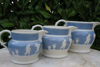 Set 3 GRADUATED SIZE JUGS Blue & white figures in relief