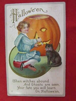 1900's Halloween Postcard Young Girl Carving a Pumpkin w Black Cat 1 Cent Stamp