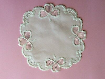Vintage  embroidered round doily with bows.