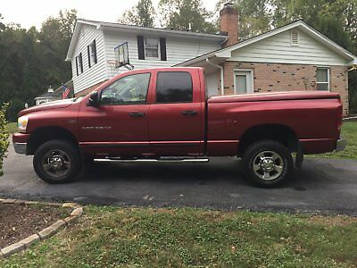 2006 Dodge Ram 2500  2006 Dodge ram 2500 Burgandy 4dr quad cab 6' bed new tireswith Western Snow Plow