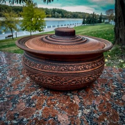 The ceramic casserole is ancient, in Greek style. Handmade red clay