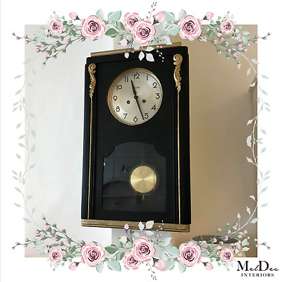 Black and Gold Wall Clock With Pendulum