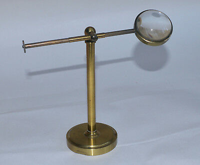 Brass bulls-eye on stand for brass microscope.