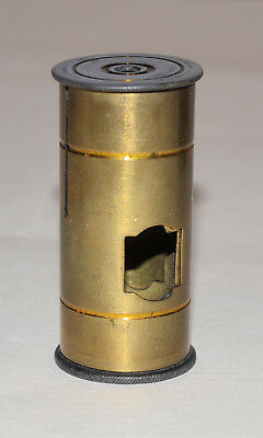 Unknown item maybe for old brass microscope. Sleeve with lens.