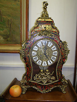 A statuesque Boulle clock,8 day movement striking bells