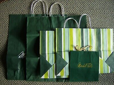 5 Classic Marshall Fields Paper Shopping Bags  2 striped and 2 lg green  1 small