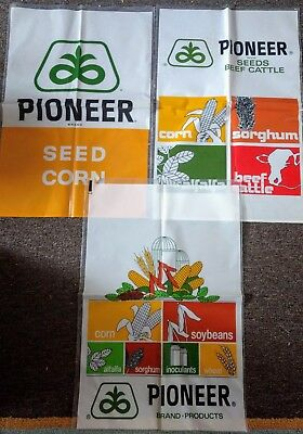 Three PIONEER SEED HYBRIDS SEED SACKS....UNUSED & NICE!