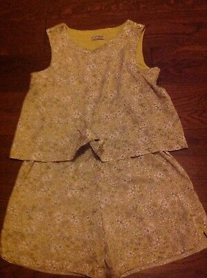9-year old playsuit from Next. In very good condition