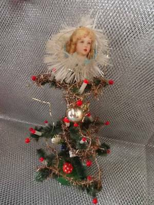 An Antique Christmas Heirloom Tiny Christmas Tree With Decorations