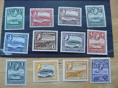 Antigua: stock of old stamps m&u on pages & loose (9 photos)
