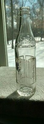Le Co Pure Beverage Co. Inc., Marietta, PA 7 oz., Embossed Beverage Bottle