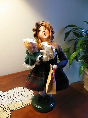 """9 1/2"""" BYERS CHOICE Traditional Girl Shopper 2012 Caroler with Doll, Gift & Bag"""
